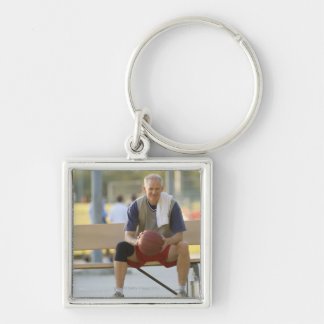 Portrait of mature man with basketball sitting Silver-Colored square key ring