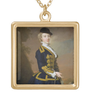 Portrait of Nancy Fortesque wearing a dark blue ri Gold Plated Necklace