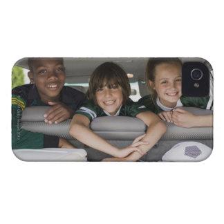 Portrait of smiling children in car iPhone 4 case