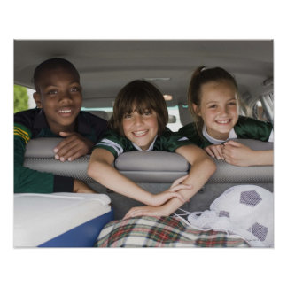 Portrait of smiling children in car poster