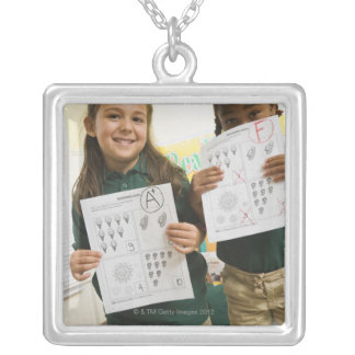 Portrait of two preschool girls with A plus and Square Pendant Necklace