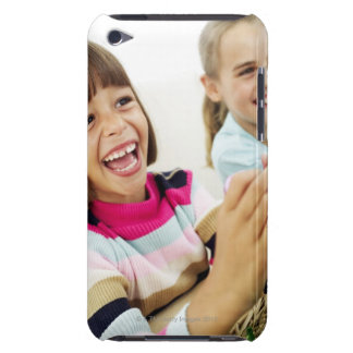 portrait of two young girls playing with easter barely there iPod cases