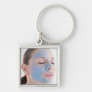 portrait of you woman with one face side covered Silver-Colored square key ring