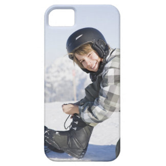 Portrait of young boy kneeling to tie ski boot, barely there iPhone 5 case