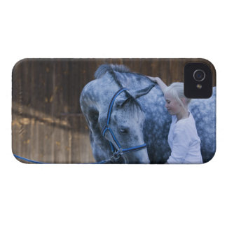 portrait of young girl holding white horse iPhone 4 cases