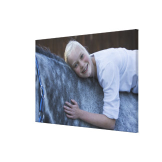 portrait of young girl on white horse canvas print