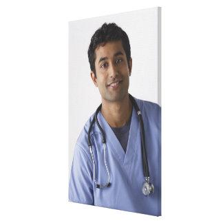 Portrait of young male nurse, studio shot canvas print