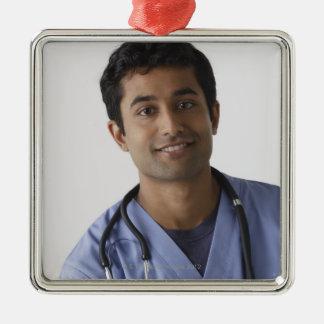 Portrait of young male nurse, studio shot Silver-Colored square decoration