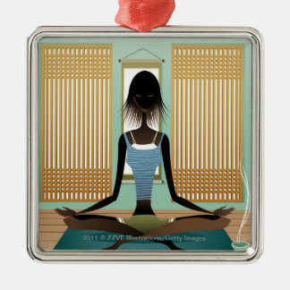 Portrait of young woman doing yoga christmas ornament