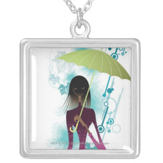 Portrait of young woman holding purse and umbrella silver plated necklace