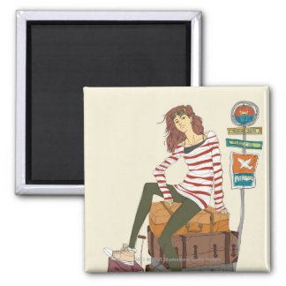 Portrait of young woman sitting on suitcase magnet
