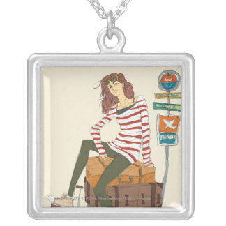 Portrait of young woman sitting on suitcase silver plated necklace