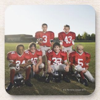 Portrait of youth football team on field beverage coaster