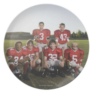 Portrait of youth football team on field party plate