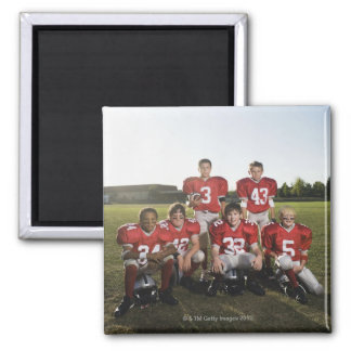 Portrait of youth football team on field square magnet