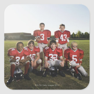 Portrait of youth football team on field square sticker