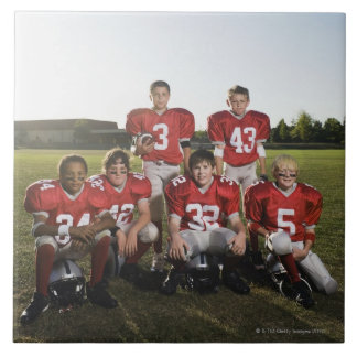 Portrait of youth football team on field tile