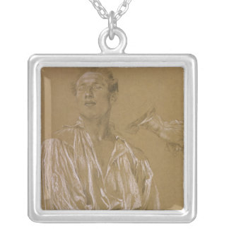 Portrait study of a man in a white shirt silver plated necklace