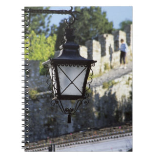 Portugal, Obidos. Iron streetlamp and 14th Notebook