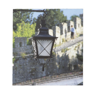 Portugal, Obidos. Iron streetlamp and 14th Notepad