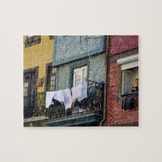 Portugal, Oporto (Porto). Woman hanging laundry Jigsaw Puzzle