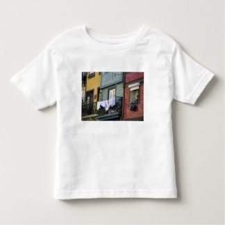 Portugal, Oporto (Porto). Woman hanging laundry Toddler T-Shirt