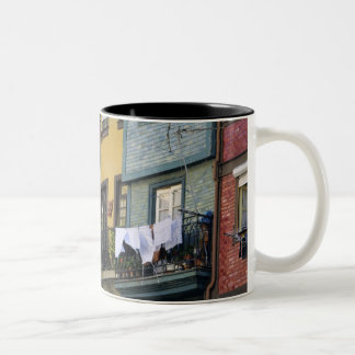 Portugal, Oporto (Porto). Woman hanging laundry Two-Tone Coffee Mug