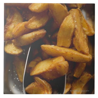 Potato wedges with salt (detail) tile