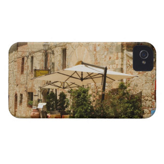 Potted plants and patio umbrellas in front of a iPhone 4 covers