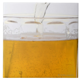 Pouring beer in glass mug, Extreme, Close-up Large Square Tile