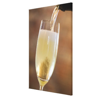 Pouring champagne canvas print