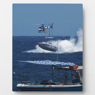 Powerboat and a helicopter plaque