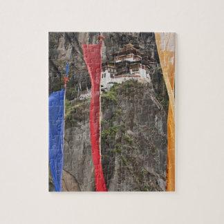 Prayer flags hang near Taktshang Jigsaw Puzzle