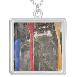 Prayer flags hang near Taktshang Silver Plated Necklace