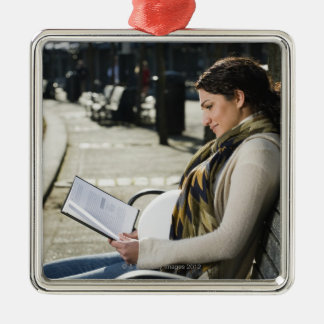Pregnant Middle Eastern woman reading on park Christmas Ornament