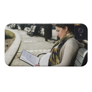 Pregnant Middle Eastern woman reading on park iPhone 4 Case