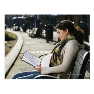 Pregnant Middle Eastern woman reading on park Postcard