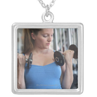 pregnant woman exercising at health club silver plated necklace