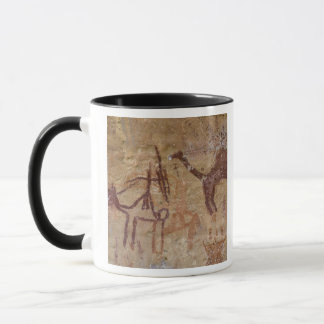 Prehistoric rock paintings with camels and mug