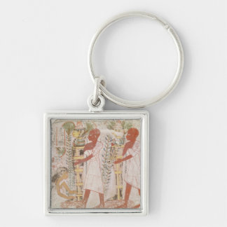 Preparation two mummies for purification ceremony key ring