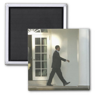 President Barack in deep thought as he walks Magnet