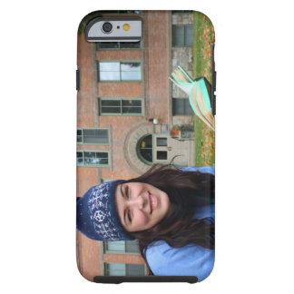 Pretty college student studying in autumn leaves tough iPhone 6 case