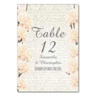Pretty pale peach floral flower blossom wedding table card