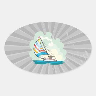 pretty sailboat sailing in the sea oval sticker