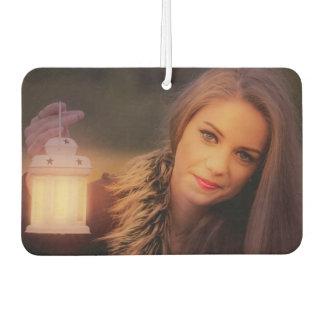Pretty woman with a lantern car air freshener