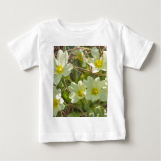 primroses in the meadow in spring baby T-Shirt