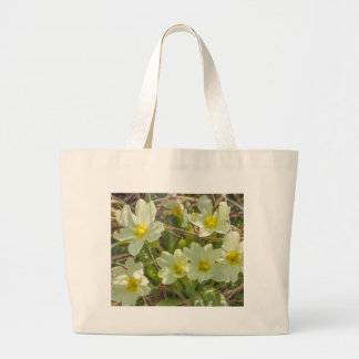 primroses in the meadow in spring large tote bag