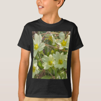primroses in the meadow in spring T-Shirt