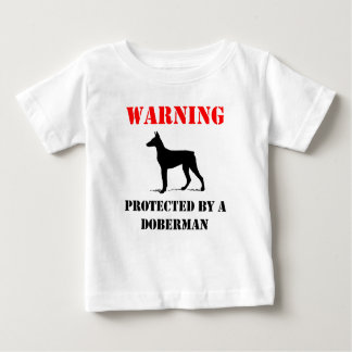 Protected By A Doberman Baby T-Shirt