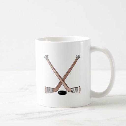 puck and hockey sticks design mug